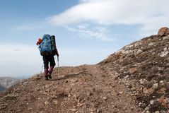 Hiker in a mountain Royalty Free Stock Photos