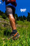 Hiker on Mountain. Green grass and blue sky Royalty Free Stock Images