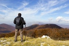 Hiker on mountain Stock Images