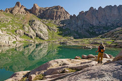 Hiker By Mountain Lake Stock Images