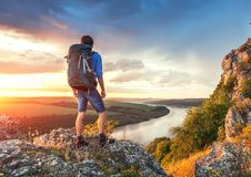 Hiker on a mountain looking forward. royalty free stock photos