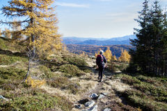 Hiker on mountain path Stock Photography