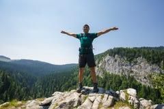 Hiker on the mountain peak Stock Photos