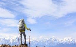 Hiker on mountain peak Stock Photos