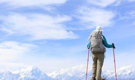Hiker on mountain peak Stock Images