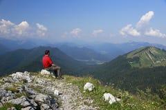 Hiker on mountain peak Royalty Free Stock Photo