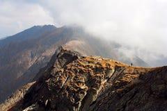 Hiker on mountain ridge Stock Photos