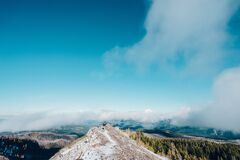 Hiker on mountain summit Royalty Free Stock Images