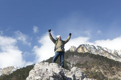 Hiker on a mountain top Royalty Free Stock Photo
