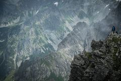Hiker on a mountain Stock Photography