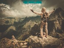 Hiker on a mountain Royalty Free Stock Images