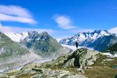 Hiker on mountain top rock. stock photo