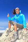 Hiker at mountain top summit. Hiker woman at mountain top summit enjoying view giving success thumbs up sign smiling happy of her hiking achievemant. Beautiful Royalty Free Stock Photography