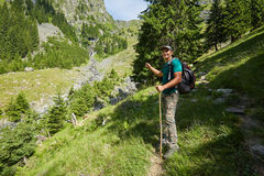 Hiker on a mountain trail Stock Photos