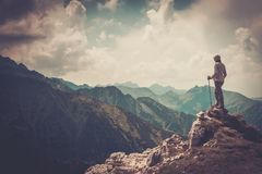 Hiker on a mountain. Woman hiker on a top of a mountain Royalty Free Stock Images