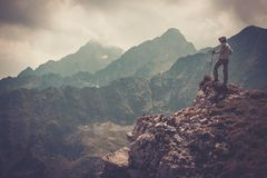 Hiker on a mountain Royalty Free Stock Image