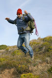 Hiker/mountaineer on a jump Royalty Free Stock Photos