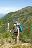 Hiker in a mountains Royalty Free Stock Photography