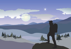 Hiker in mountains. Moonlight landscape Royalty Free Stock Images