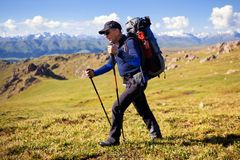 Hiker in mountains Royalty Free Stock Photo