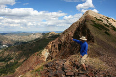 Hiker in mountains Stock Image
