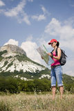 Hiker in the mountains. Woman with the map in the mountains Stock Images