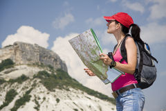 Hiker in the mountains. Woman with the map in the mountains Royalty Free Stock Images