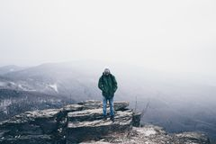 Hiker in the mountains in bad weather