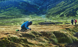 Hiker in the mountains, Iceland. Hiker on the trail in the Islandic mountains. Trek in National Park Landmannalaugar, Iceland. woman doing a picture moss on the Stock Photo