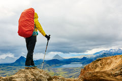 Hiker in the mountains, Iceland. Woman hiker on the trail in the Islandic mountains. Trek in National Park Landmannalaugar, Iceland Stock Photos