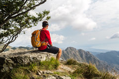 Hiker in mountains looking at view Stock Photography