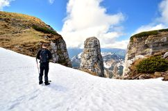 Hiker in mountains. Royalty Free Stock Photo