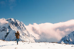 Hiker in mountains in winter Royalty Free Stock Photos
