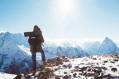 Hiker in mountains in winter Stock Images