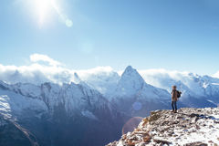 Hiker in mountains in winter Royalty Free Stock Images