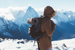 Hiker in mountains in winter Stock Photo