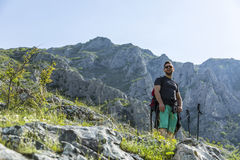 Hiker in Mountains. A young man taking a break during his hiking in the Apuseni Mountains in Transylvania, Romania Royalty Free Stock Photos