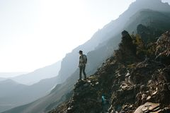 Hiker on mountainside Royalty Free Stock Images