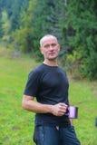 Hiker with a mug Stock Image