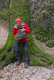 Hiker with mushroom in Slovak karst Mountains Royalty Free Stock Photography