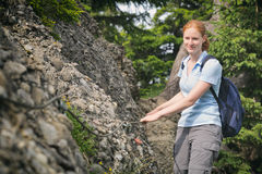 Hiker on a Narrow Alpine Trail Royalty Free Stock Photos