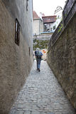 Hiker in Narrow Street Stock Photo