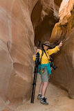 Hiker in Narrows. A hiker gives a thumb's up to making it through a slot canyon in southwestern Utah, USA Stock Photos