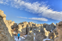 Hiker in Natural Fort rock formation Royalty Free Stock Photos