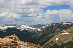 Hiker on natural viewpoint enjoy Rocky Mountains Royalty Free Stock Photography