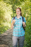 Hiker Navigating with Digital Maps Royalty Free Stock Photos