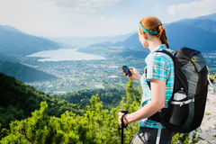 Hiker Navigating with a GPS Device Stock Images