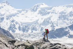 Hiker near Belukha Mountain, the highest in Siberia Royalty Free Stock Image