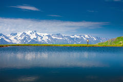Hiker near the mountain lake. In Svaneti, Georgia. Caucasus mountains Royalty Free Stock Photography