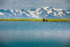 Hiker near the mountain lake. In Svaneti, Georgia. Caucasus mountains Stock Photography